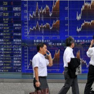 Borse Asia: pesano energia e commodities